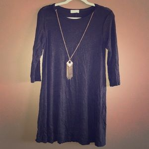Black dress with golden necklace